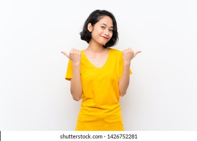 Asian young woman over isolated white background with thumbs up gesture and smiling