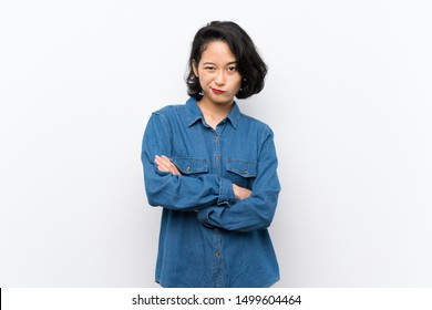 Asian young woman over isolated white background feeling upset