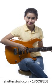 Asian Young woman playing with Guitar on White background