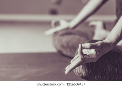 Asian young woman practicing yoga in  gray background.Young people do yoga indoor.