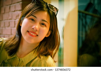Asian young woman with smart phone