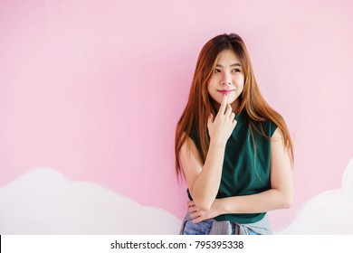 Asian Young Woman in Thoughtful with Smiling Face , Hand on Chin, Emotional of Female Concept, Portrait, Front view