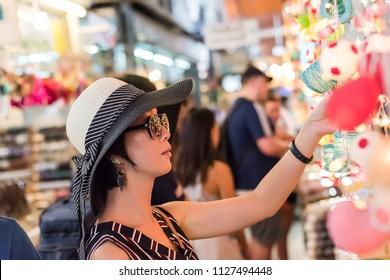 asian young woman traveling and shopping at Chatuchak weekend market, Bangkok, Thailand