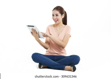 Asian young woman use of the tablet