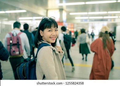 asian younger woman traveling in underground trains station of osaka japan