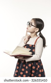 A asian(japan, chinese, korea) pretty girl hold a book and reading, thinking hard, have a questions with a worry isolated white at the studio.