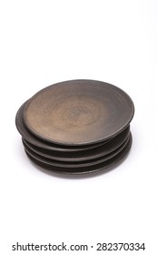 A asian(korean, japan, chinese) brown ceramic traditional dishes(coaster, saucer) isolated white background at studio.