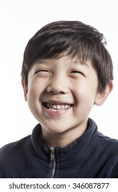 A asian(korean, japanese, chinese) boy(kid, student, child, man, male) make a portrait with a smile isolated white.