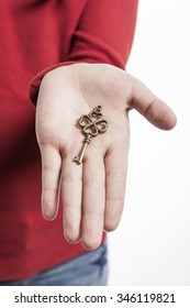 A asian(korean, japanese, chinese) girl(kid, student, child, woman, female) wearing red shirts stand up with a golden key for real estate, home,house, building isolated white.