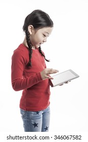 A asian(korean, japanese, chinese) girls(kid, student, child, woman, female) wearing red shirts and blue denim hold and watch(see) a digital device(pad, mobile) isolated white.