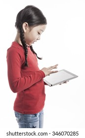 A asian(korean, japanese, chinese) girls(kid, student, child, woman, female) wearing red shirts and blue denim hold and watch(see), touch the screen a digital device(pad, mobile) isolated white.