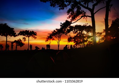 Asians traveler in happy time with beautiful atmospheric attractive environmental twilight at Phu Kradueng National Park in Loei Province of thailand