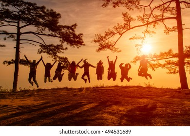 Asians traveler jumping in happy time at Phu Kradueng National Park at Sunset in Loei Province of thailand