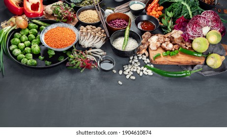Asian-styled raw vegan food, grain, seeds, vegetables, mushrooms and fish, hot and spicy. Panorama banner with copy space