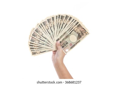 Asian'woman Hand holding Japanese banknote on white background isolated