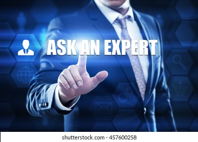 ask an expert, business,technology and internet concept. Businessman are using a virtual computer and are selecting ask an expert.