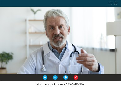 Ask general practitioner online, video call consultation, patient and doctor talk concept. Head shot of mature male therapist share information provide support, laptop screen view, videoconference app