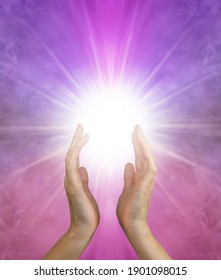 Ask and it is Given - sending healing out where it is needed - Female hands reaching up into a white star light radiating outwards on a pink purple ethereal background with copy space below