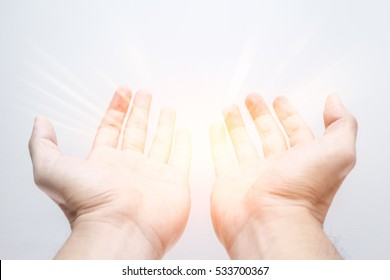 ask god bring a new think in your hand . offer posture open palm two hand with light bright