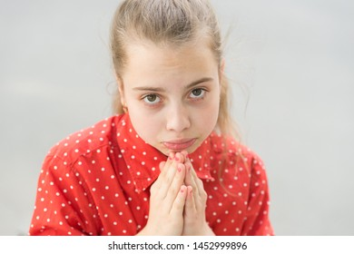 Ask permission. Banned behavior. Girl sad begging permission. Please concept. Girl helpless hold hands for pray. Let me please. Kid cute face close up. Mommy please. Forgive me. I am very sorry.