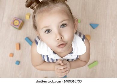 Ask permission. Banned behavior. Little girl sad begging permission. Please concept. Let me please. Kid cute face close up.