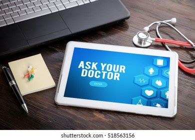 ASK YOUR DOCTOR on screen tablet pc, health concept. Information technology and mobile application in healthcare/medical.