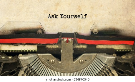 Ask Yourself typed words on a vintage typewriter with vintage background
