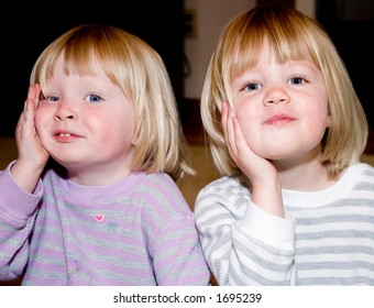 I asked these two twins girls to touch their cheeks together.  I meant for them to lean against each others cheeks but this is what I got!