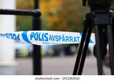ASKERSUND, SWEDEN- 3 OCTOBER 2020: Police barrier tape at a crime scene. Photo Jeppe Gustafsson