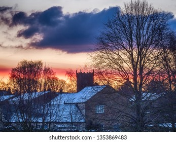 Askrigg, Wensleydale, Yorkshire Dales National Park, North Yorkshire, England, Britain, February 2019, sunrise colours over a Yorkshire Dales village