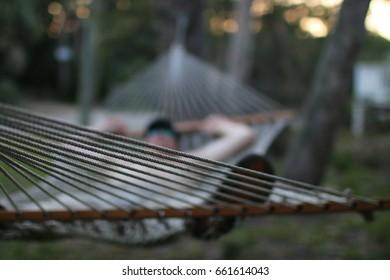 Asleep in a hammock