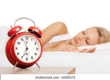 Asleep woman and alarm clock.