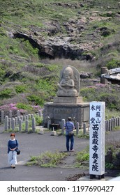 ASO VALCANO, JAPAN - MAY 14,2015: The environment of volcano mountain with statue of Japanese protected god in the area of aso volcano temple, Fukuoka