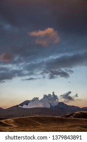 Aso volcano erupting smoke in afternoon light, Kyushu Japan