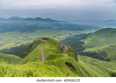 Aso volcano mountain and farmer village in Kumamoto, Japan.