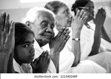 Asokaramaya Buddhist Temple, Colombo, Sri Lanka. 16/03/2018. Buddhist women praying in the temple.
