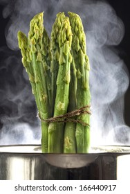 asparagus cooked in aluminum pot with water vapor