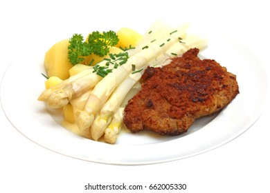 Asparagus with cutlet and potatoes