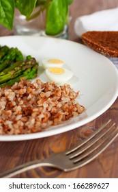 Asparagus with eggs on plate