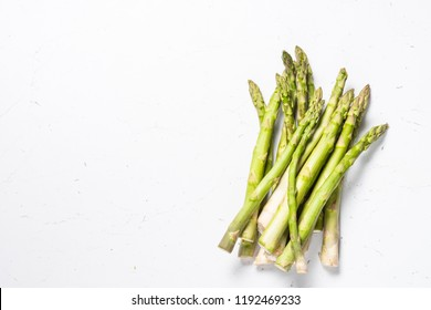 Asparagus. Fresh green asparagus on white background. Top view copy space.