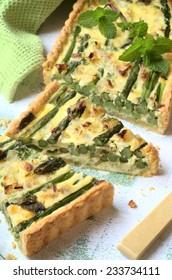asparagus, fresh herbs and ricotta tart. selective focus