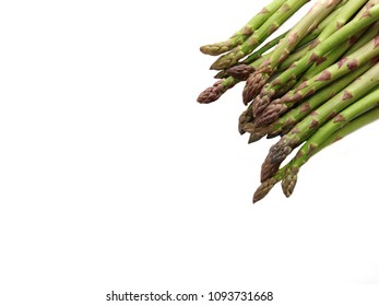 Asparagus isolated. Fresh raw green asparagus on a white background. Close up. Space for text