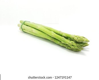 Asparagus on a white background.It is a source of vitamin K, vitamin B, folate, vitamin C and vitamin A. Rich in B vitamins B1, B2, B3 and B6. High amount of folic acid. It is rich in minerals.