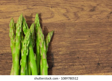 Asparagus on a wooden background