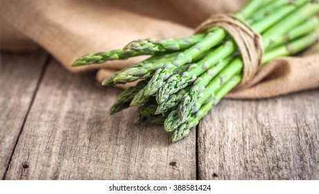 Asparagus on wooden table