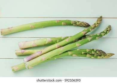 Asparagus on woody background, top view