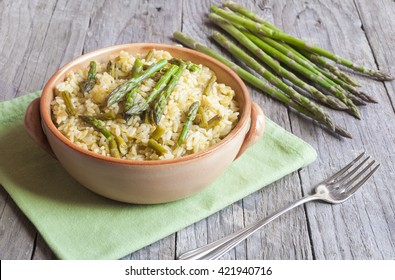 Asparagus risotto dish on wooden table