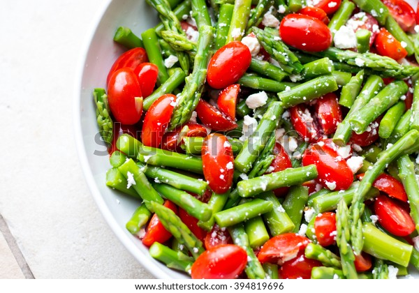 asparagus salad in a white plate