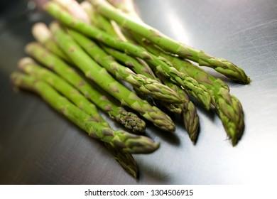 Asparagus vegetable on a metal surface.