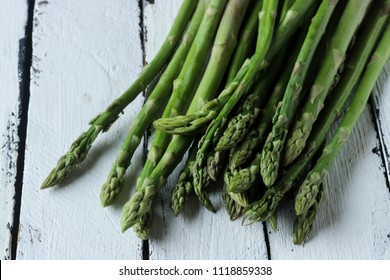 Asparagus vegetable on a white wooden background